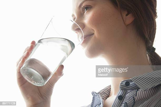 Young women drinking water