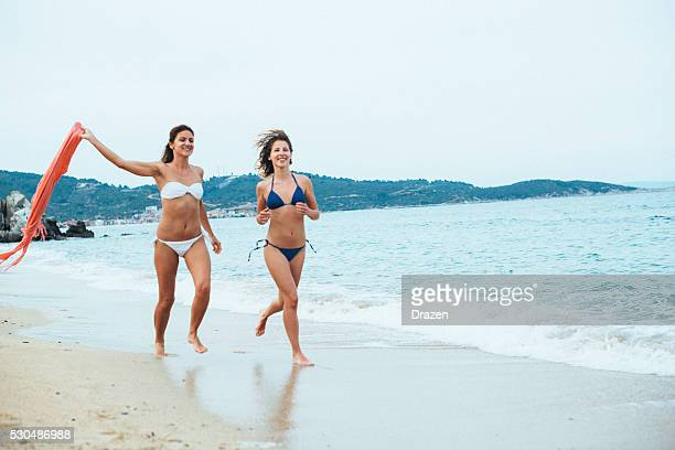 Young women enjoying girls holiday at beach on Greek island