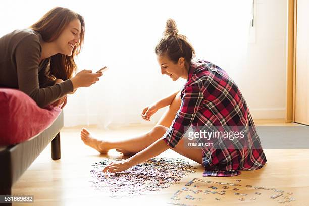 Young women enjoying weekend activities at home