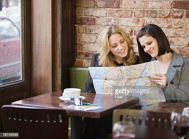 Young Women Examining a City Map