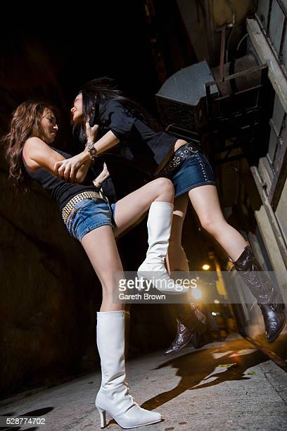 Young Women Fighting in Alley