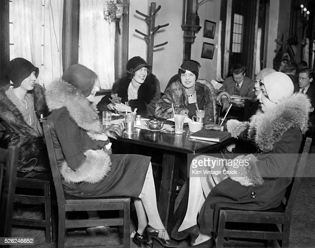 Young women gather for ice cream drinks in a restaurant setting in Chicago
