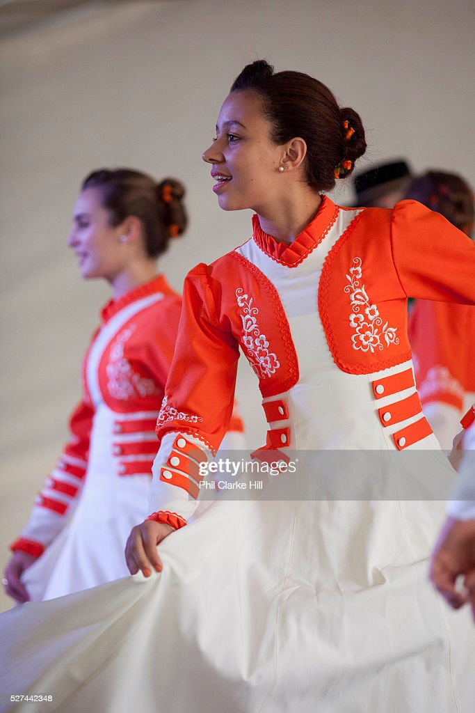 Young women girls teenagers dancing on stage in couples wearing traditional Gaucho dancing costumes for a performance Reponte da Cancao music...