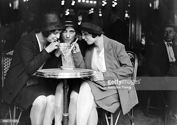 Young women having a drink in a cafe during the heat wave in July 1929 in Paris France