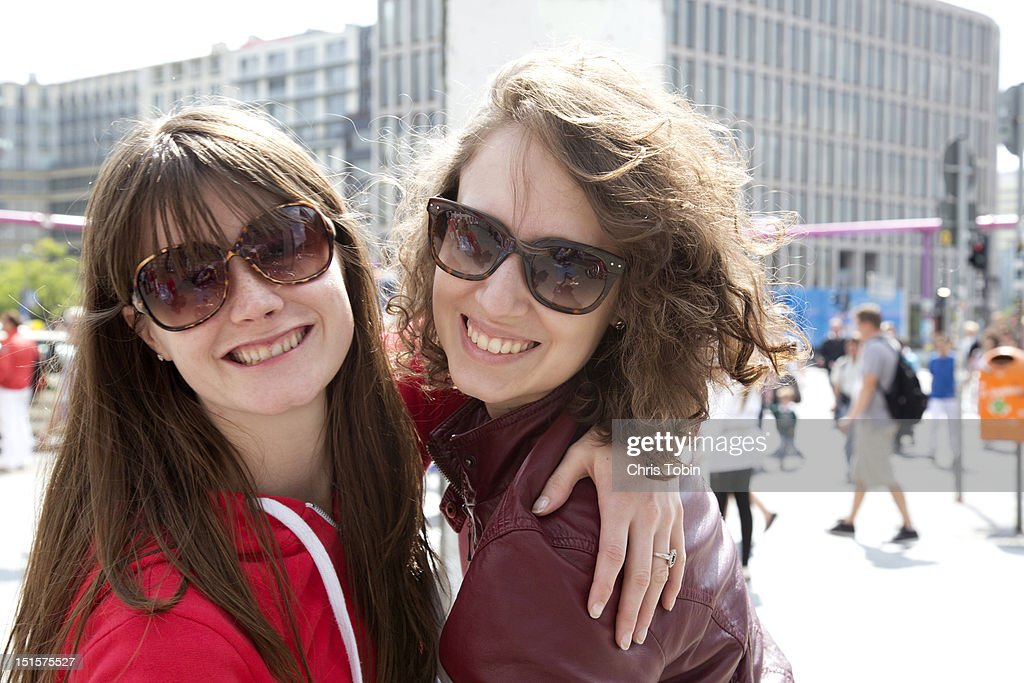 Young women having fun in the city : Stock Photo