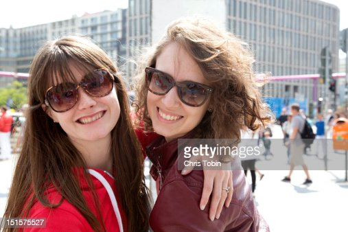 Young women having fun in the city : Stock Photo