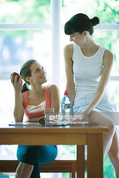 Young women having healthy snack