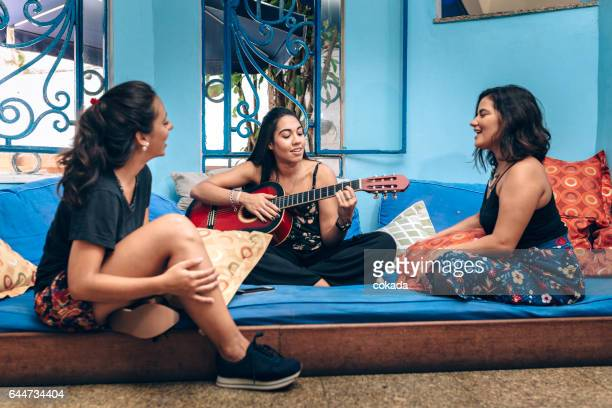 Young women having music time