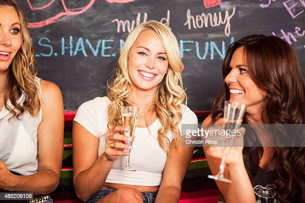 Young women holding champagne glasses