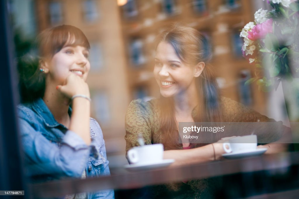 Young women in cafe : Stock Photo