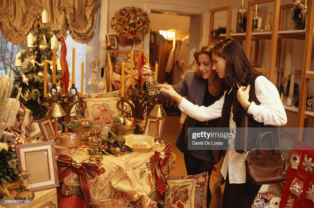Young women in Christmas shop : Stock Photo