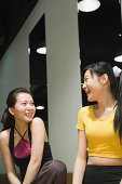 Young women in gym talking and laughing