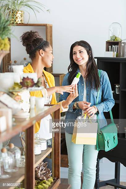 Young women in retail shop