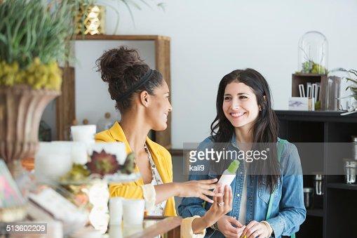 Young women in retail shop