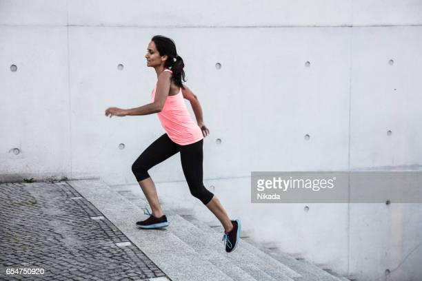 young women jogging on steps