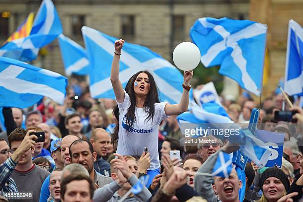 A young women joins Yes activists as they gather in George Square on September 17 2014 in GlasgowScotlandThe referendum debate has entered its final...