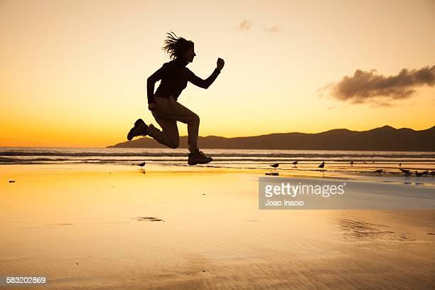 Young women jumping