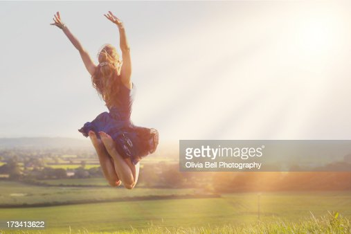 Young women jumping towards sunshine