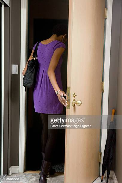 Young women leaving their apartment