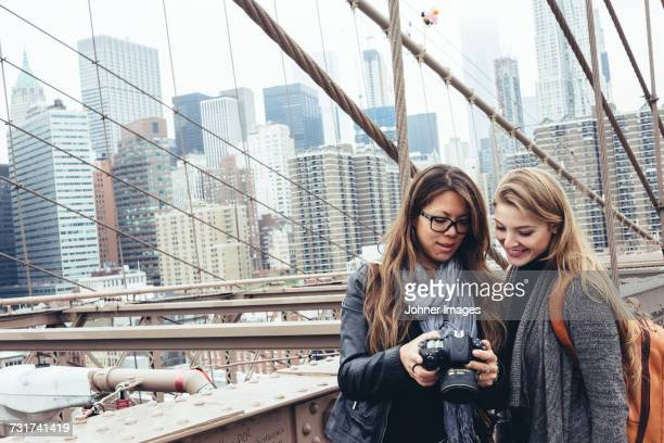 Young women looking at digital camera