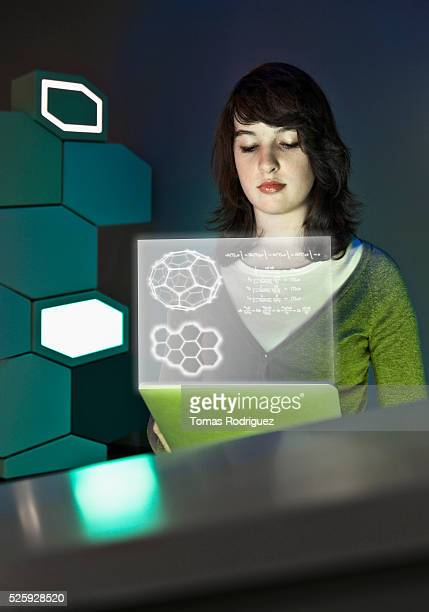 Young women looking at projection screen with mathematical formulas
