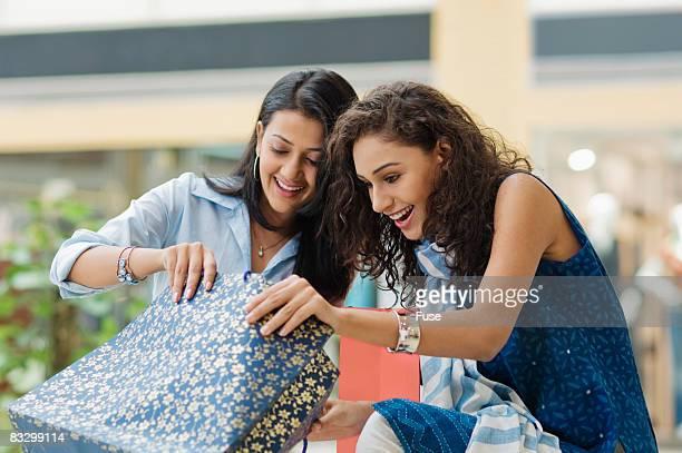 Young Women Looking in Shopping Bag