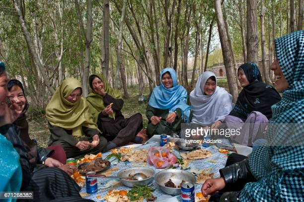 Young women many of them studying to become teachers relax in the Women's Garden of a park intended for families outside the city of Bamiyan...