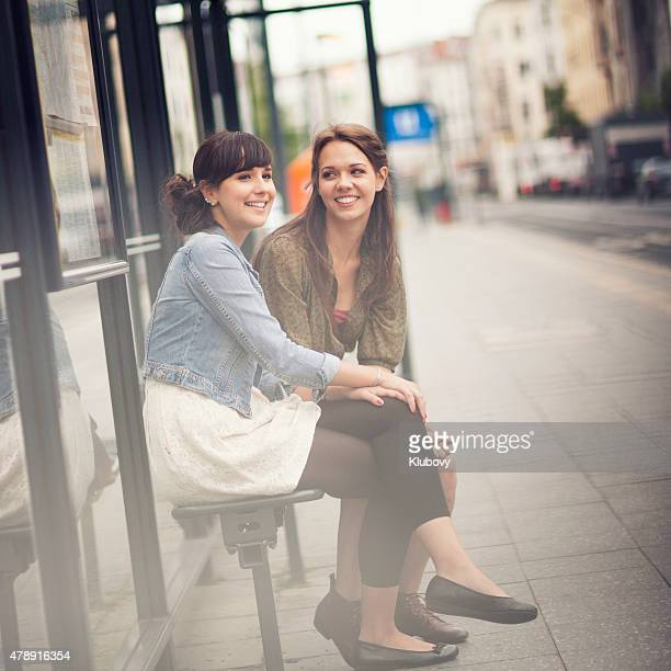 Young women on a bus stop