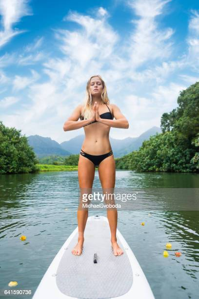 Young Women On A Paddle Board