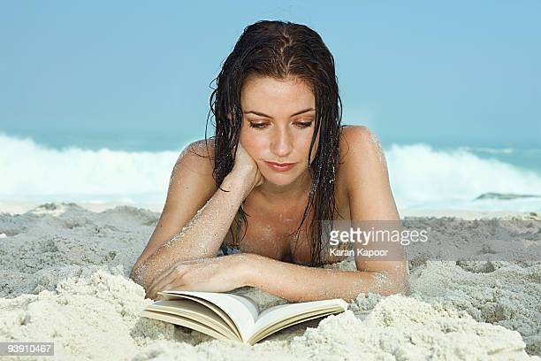 Young Women on Beach reading a book