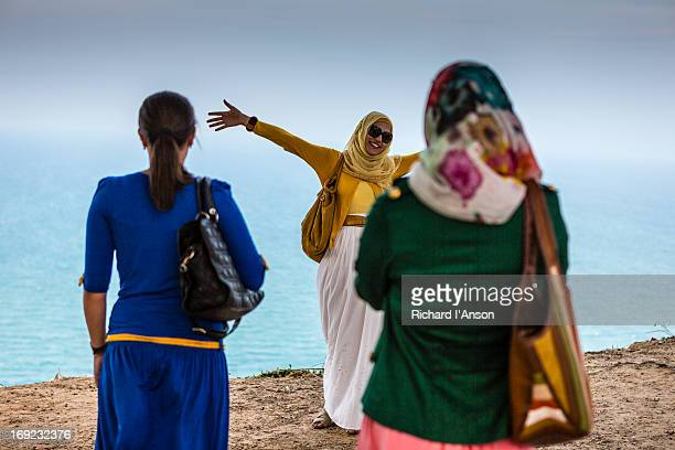 Young women on cliff top in Sidi Bou Said