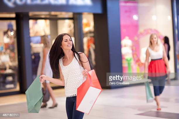 Young women on shopping spree in mall