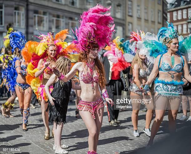 Young women parading in the Copenhagen Whitsun Carnival, 2016.