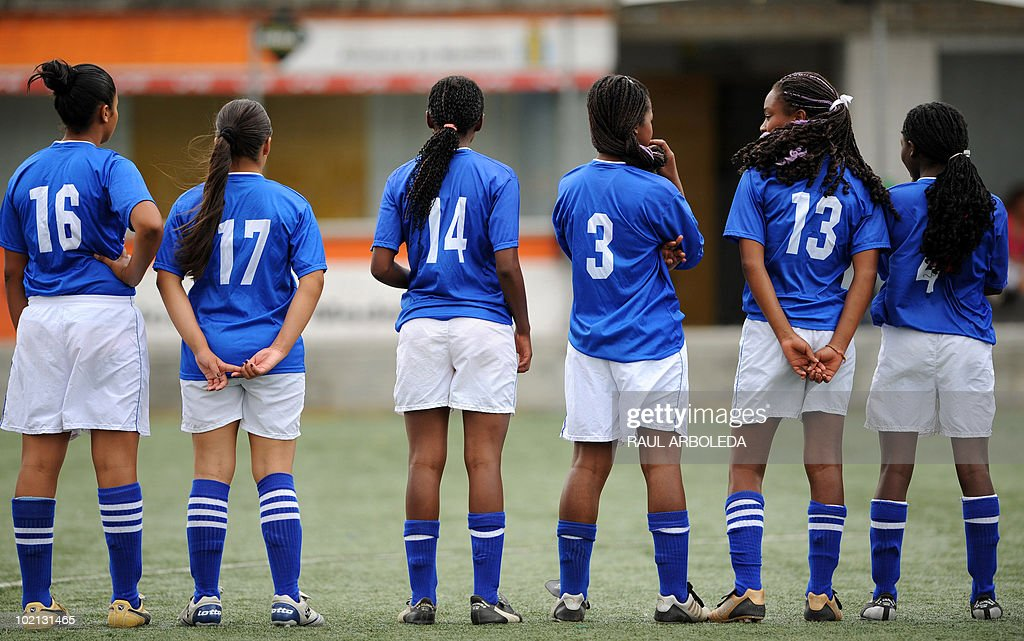 Young women players wait in line for the beginning of a match during the 'Mundialito' football tournament in Medellin, Antioquia department, Colombia on June 15, 2010. The 'Mundialito' tournament takes place every four years with the participation of Medellin soccer schools. AFP PHOTO/Raul ARBOLEDA