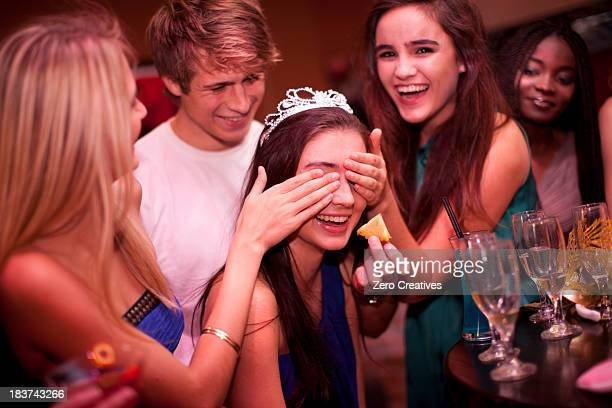 Young women playing drinking game at hen party