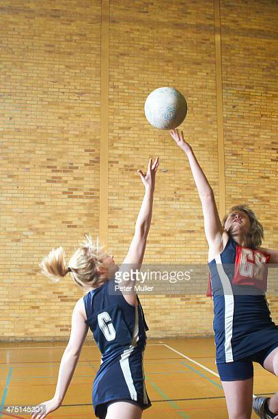 Young women playing netball