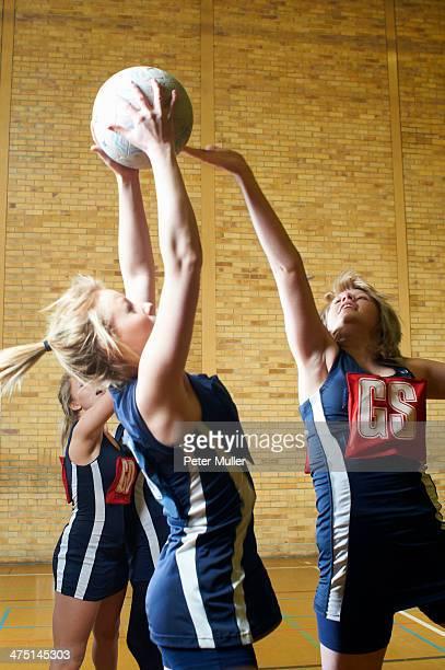 Young women playing netball