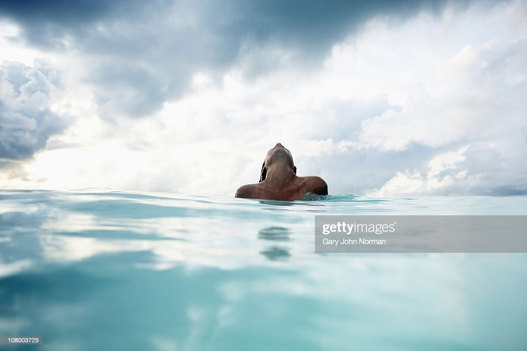 Young women plays in water : Stock Photo