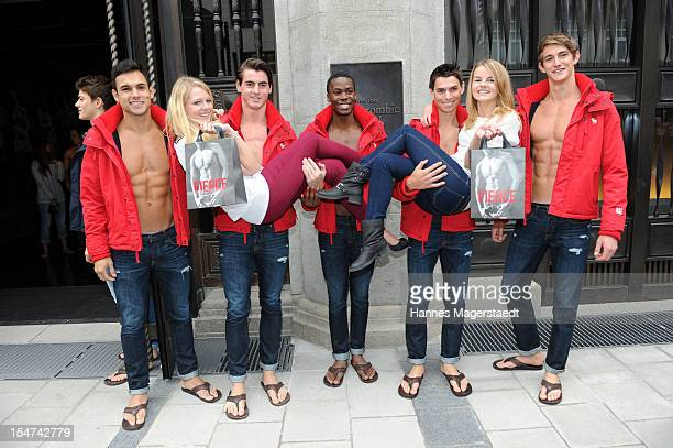 Young women pose for photographs with male models outside the Abercrombie Fitch flagship clothing store during the opening of Abercrombie Fitch...