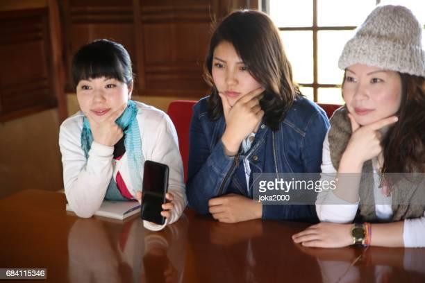 Young women posing in cafe