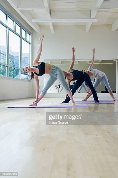Young women practising yoga