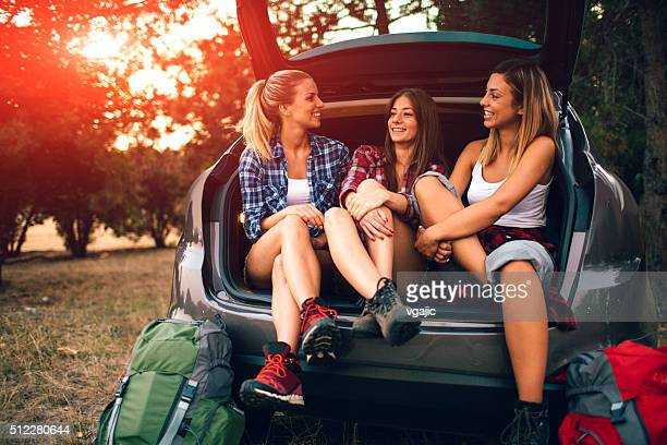 Young Women Preparing For Hike and Camping In Forest.
