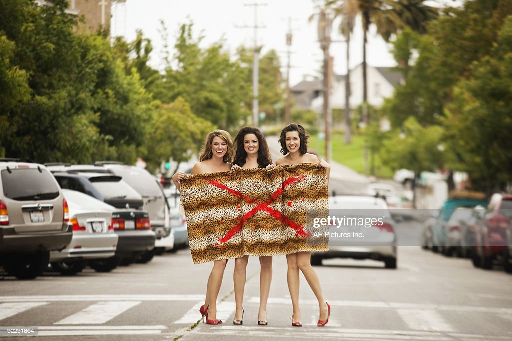 Young women protest fur on city street : Stock Photo