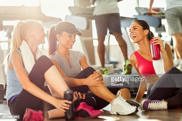 Young women relaxing after workout