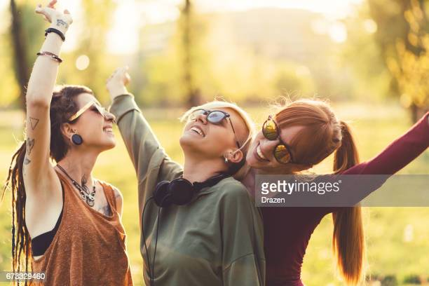 Young women relaxing with music on music festival