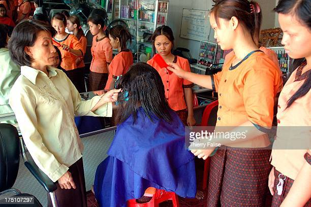 Young women rescued from a brothel by AFESIP learn hair treatment in a beauty salon also run by the organization The AFESIP is an international NGO...