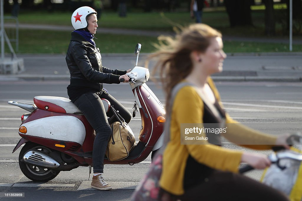 Young women ride mopeds on September 6, 2012 in Berlin, Germany. What today is the German capital and a hip metropolis popular with tourists began as a 13th-century trading settlement on the Spree River.The city of Berlin is currently holding a series of exhibitions and events ahead of its 775th anniversary, which it will celebrate at the end of October. Berlin's sister settlement of Coelln is first referred to in a document from 1237, and by the beginning of the 14th century Coelln and Berlin, which stood on either side of the Spree River, joined together to become the region's most important trading center.