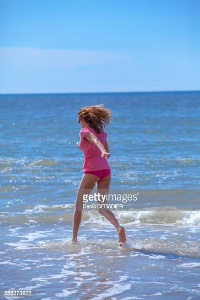 Young women running in the water, Pas de Calais, Bitch.