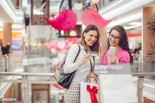 Young women shopping together in a shopping mall