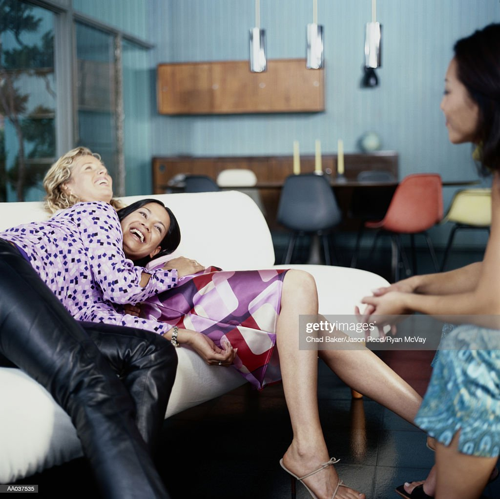 Young Women, Sitting Around House, Laughing